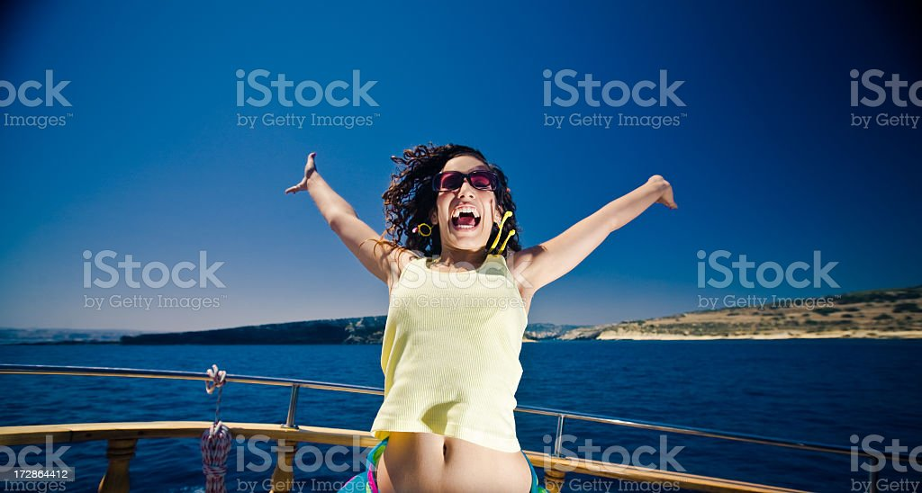 Young excited lady on a boat royalty-free stock photo
