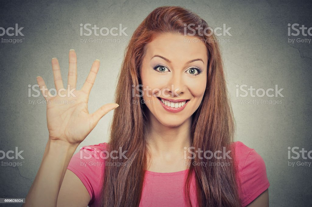 young excited woman, making five times sign gesture with hand fingers stock photo