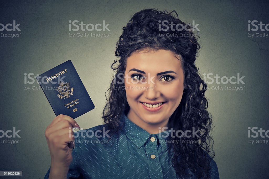 young excited woman with USA passport stock photo