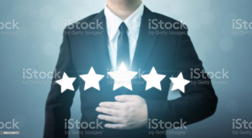 Young executive businessman in suit and five star symbol to increase rating of company, The excellence of the business or service concept stock photo