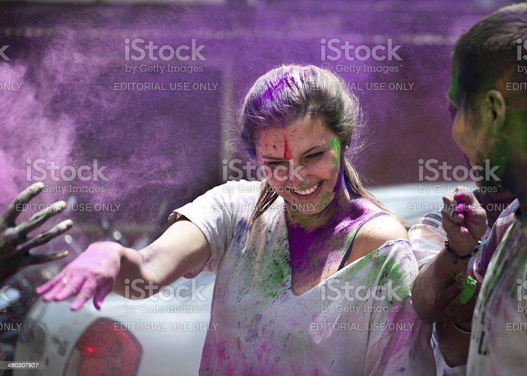 Young expat lady enjoying Holi festival in India royalty-free stock photo