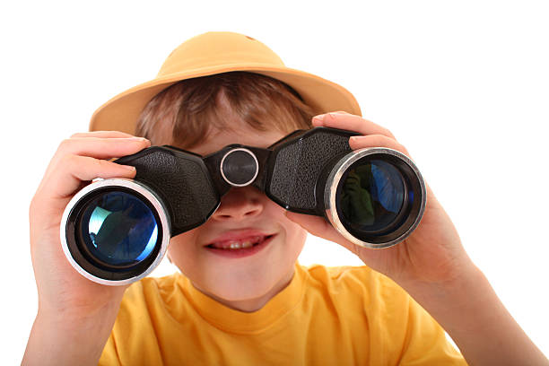 young explorer boy using binoculars - binocular boy bildbanksfoton och bilder