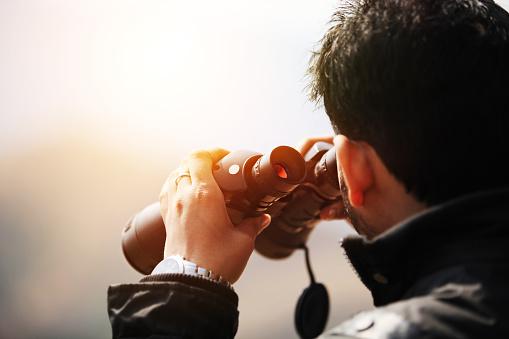 Young explorer looking through binoculars