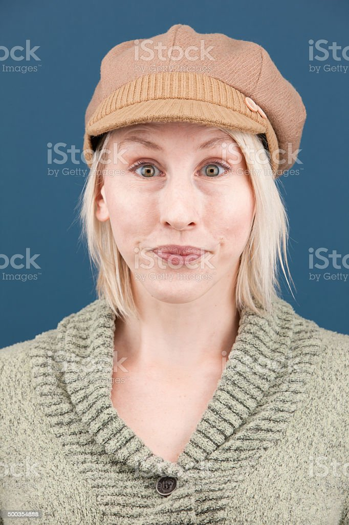 a48a4f6bd Young Expressive Blonde Woman With Short Hair And Hat Stock Photo ...