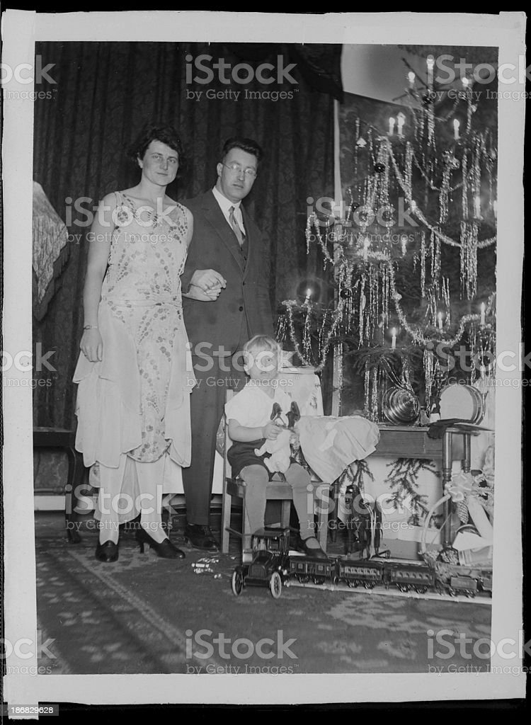 Young family and christmas tree (vintage) stock photo