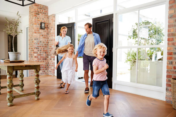 Young family arriving back to their home Young family arriving back to their home model home stock pictures, royalty-free photos & images