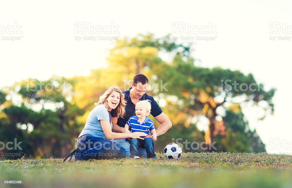 Young Family at a park stock photo