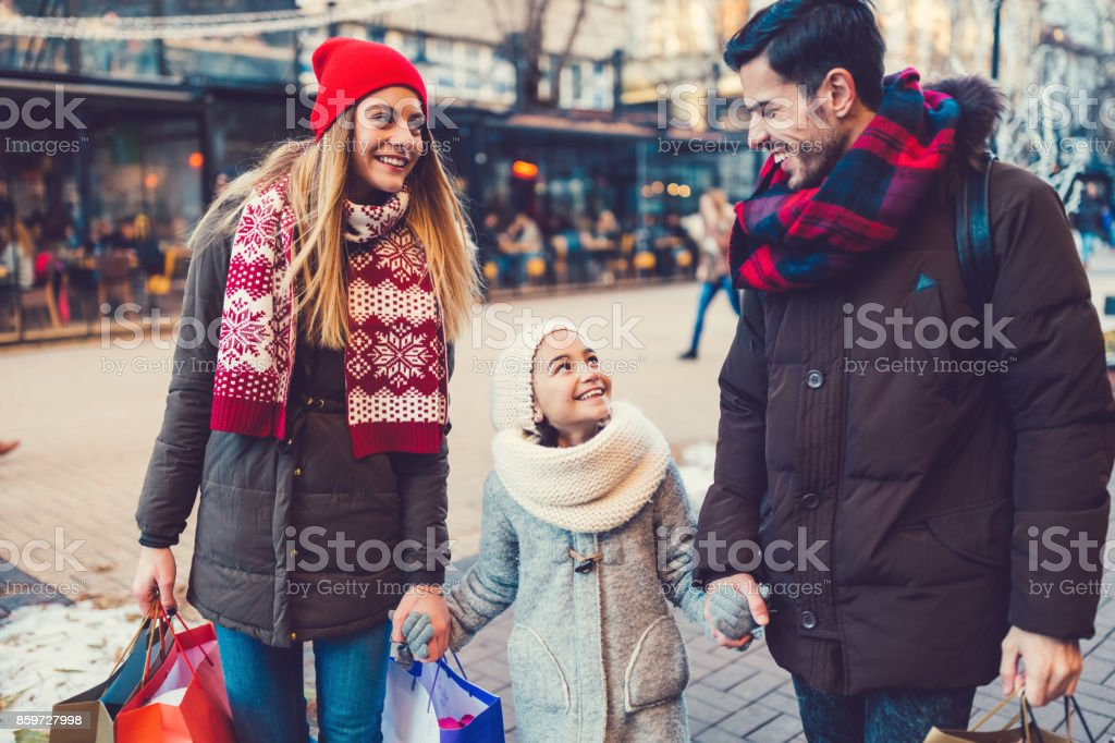 Family enjoying a shopping weekend before New Year and Christmas