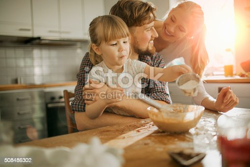 Close up of a young family enjoying baking together