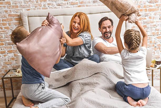 young family being playful at home - happy weekend bilder stock-fotos und bilder