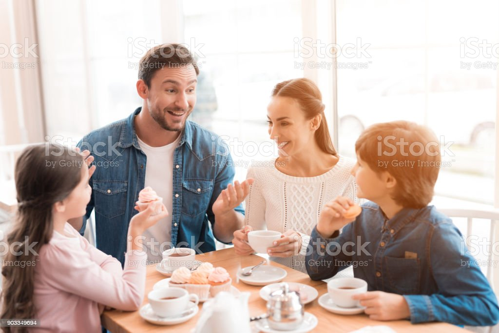 A young family came together in a cafe. stock photo