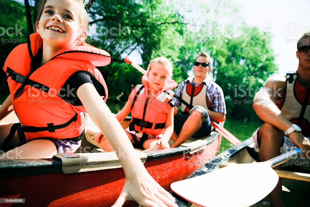 young family canoeing royalty-free stock photo