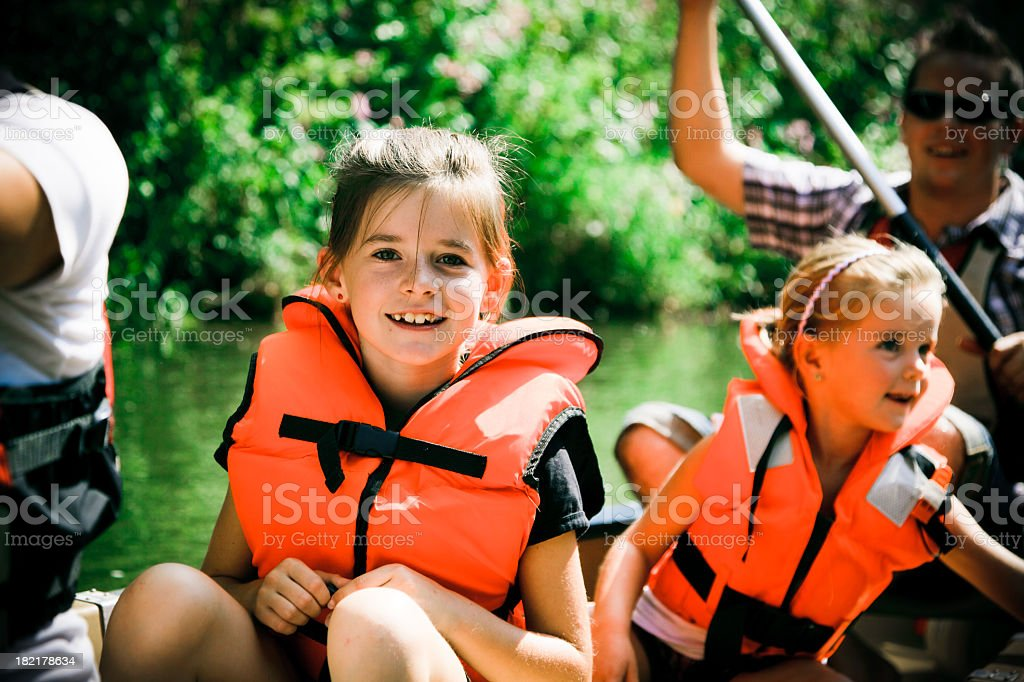 young family canoeing stock photo