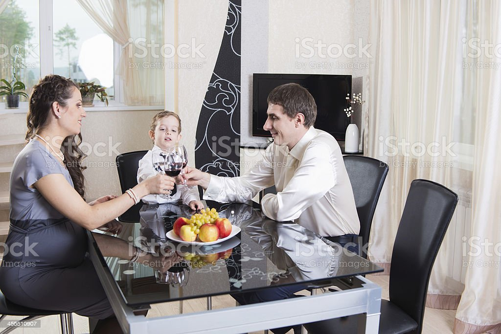 Young family celebrating at home royalty-free stock photo
