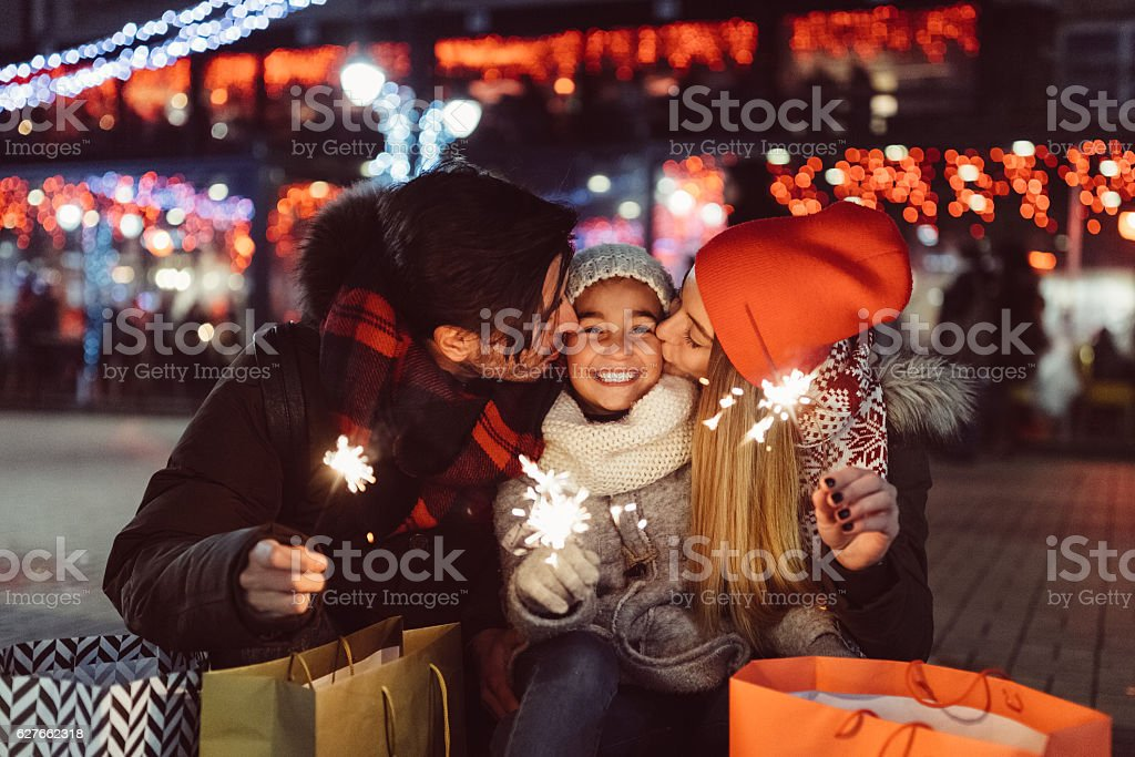Young family celebrating Christmas - Photo