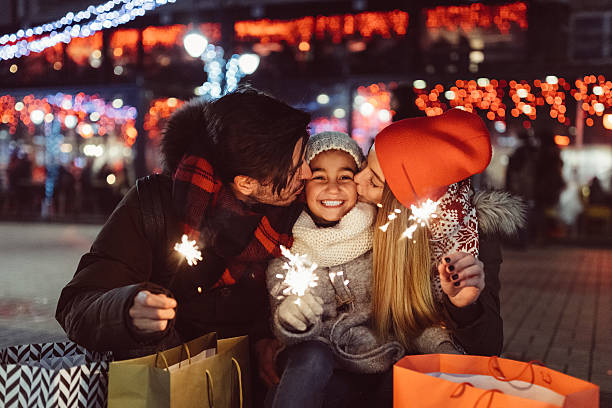 Young family celebrating Christmas stock photo