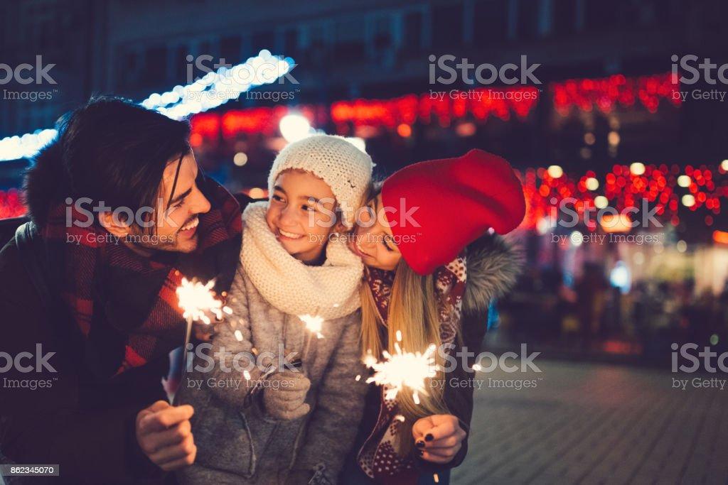 Young family celebrating Christmas stock photo