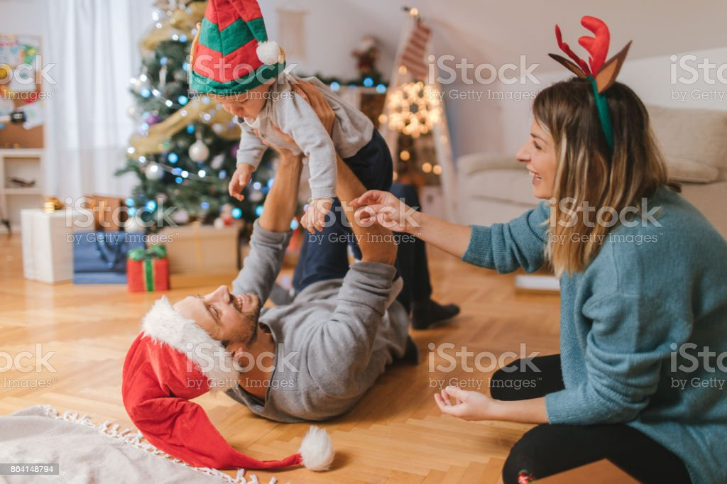 Young family celebrating Christmas royalty-free stock photo