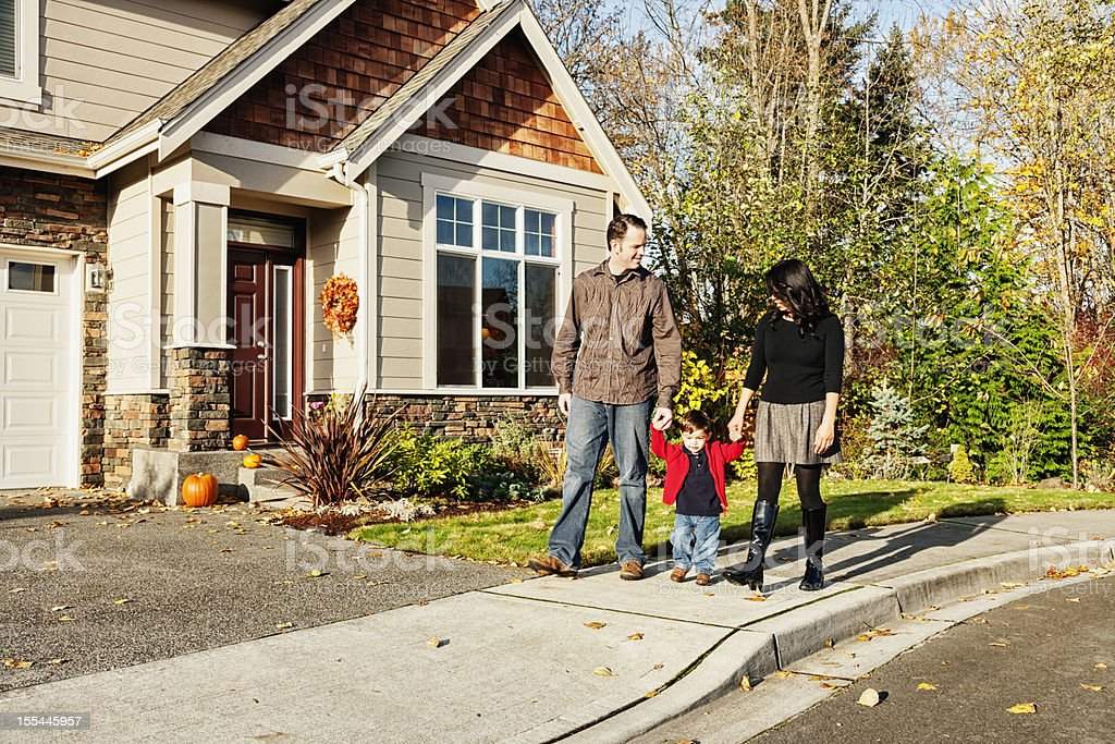 Young Family Coming Home From a Walk royalty-free stock photo