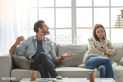 istock Young family couple together at home casual 832125504