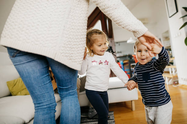 Young family dancing together stock photo