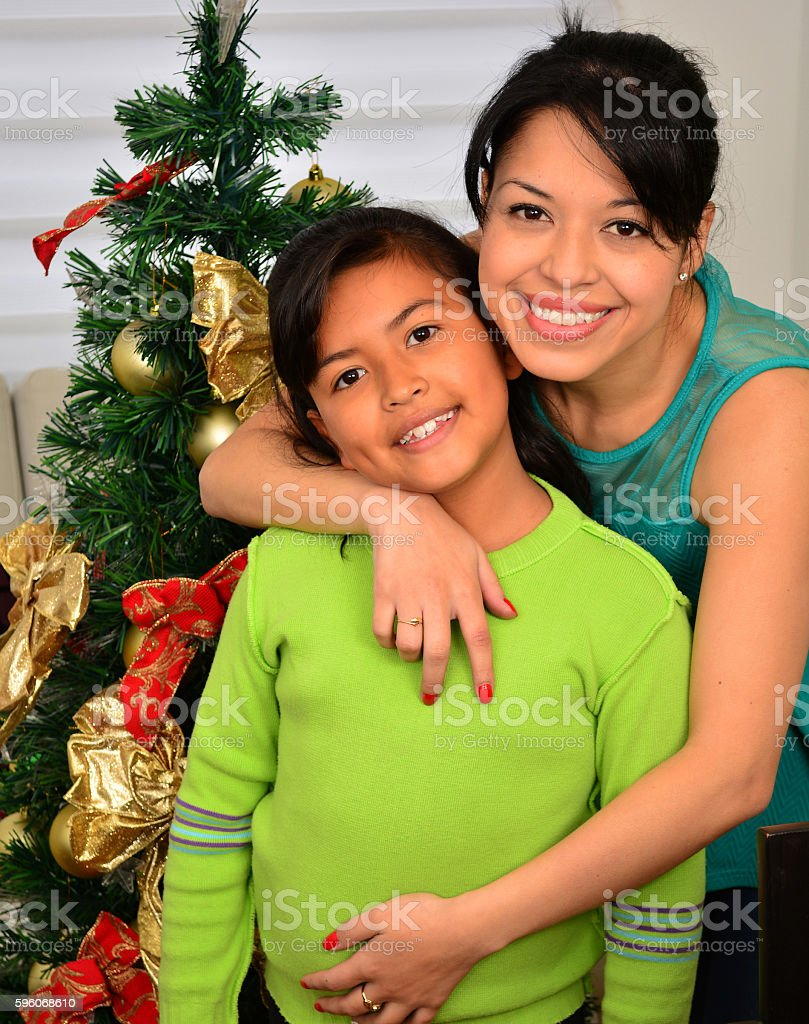 Young family decorating a Christmas royalty-free stock photo