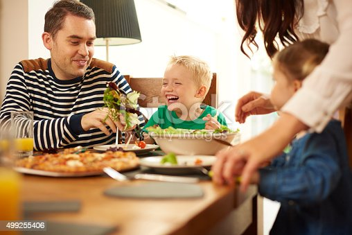 istock young family eating at the table 499255406