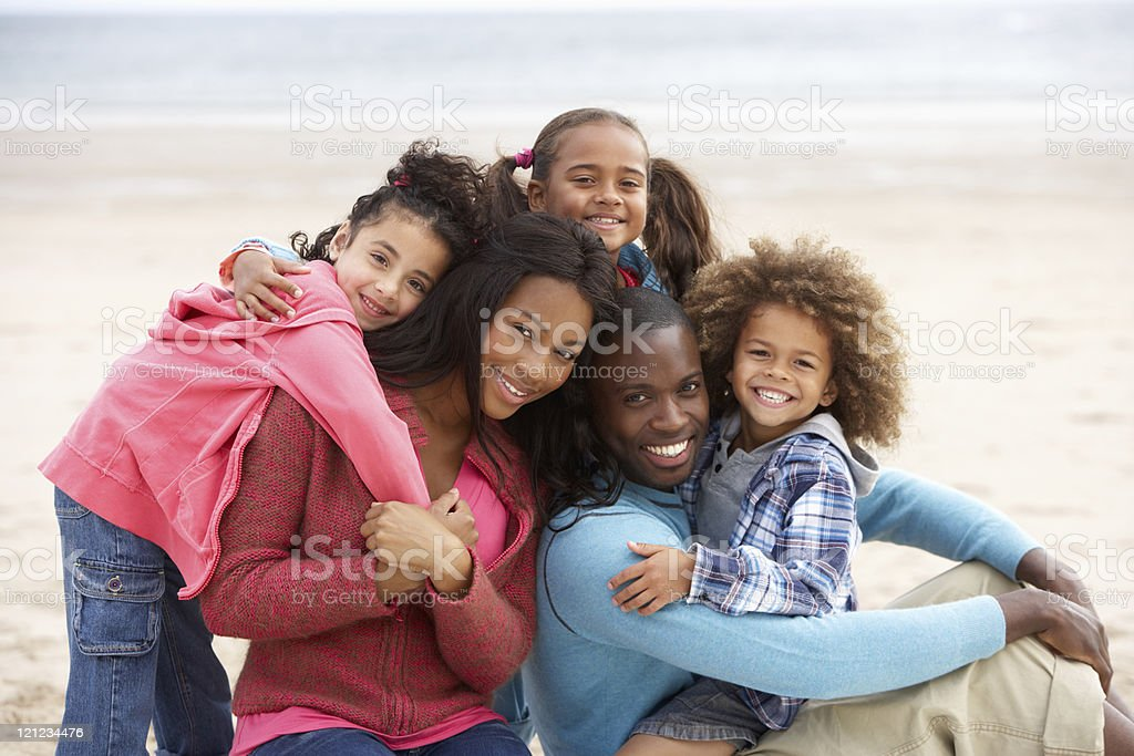 Young family embracing on beach royalty-free stock photo