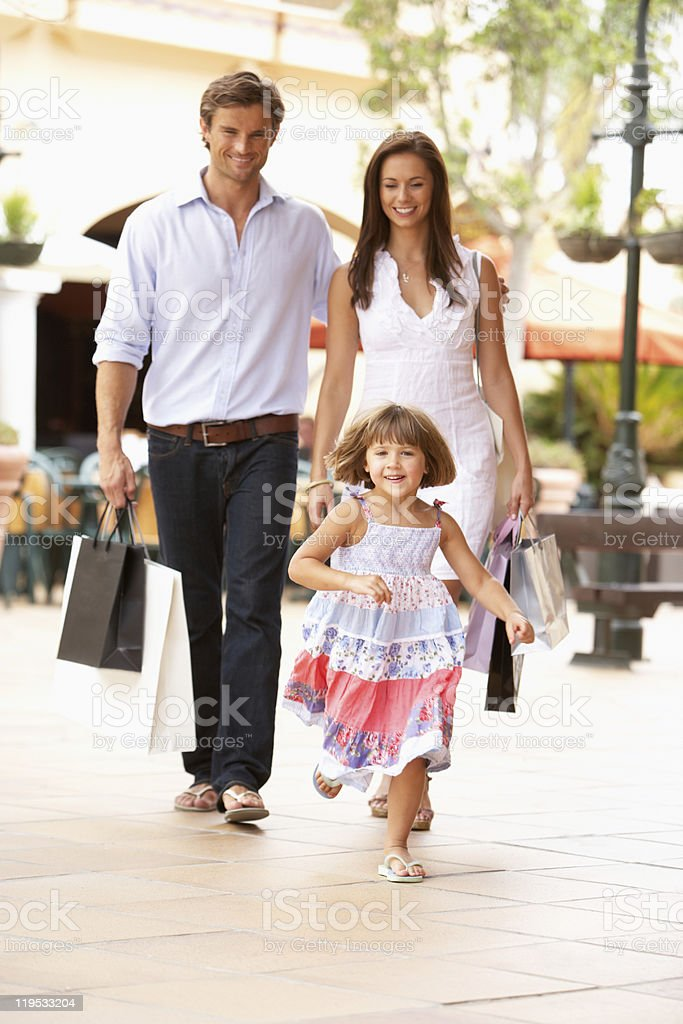Young Family Enjoying Shopping Trip royalty-free stock photo