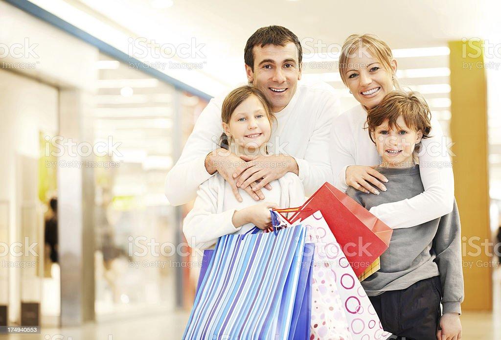 Young family enjoying while shopping. royalty-free stock photo