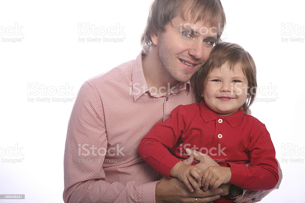 Young family father careful holding his smiling son, loking camera royalty-free stock photo