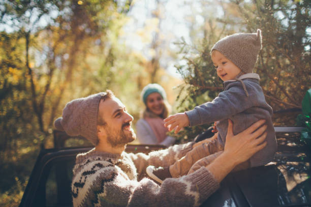 Young family have chosen their Christmas tree stock photo