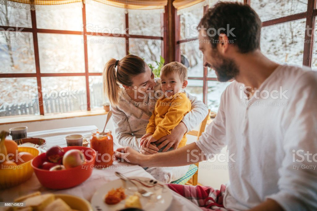 Young family having breakfast stock photo