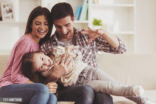 istock Young Family Having Fun. 1014887936