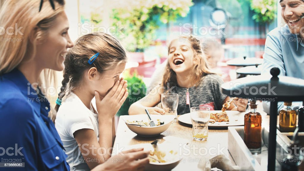 Young family having lunch at a restaurant. stock photo