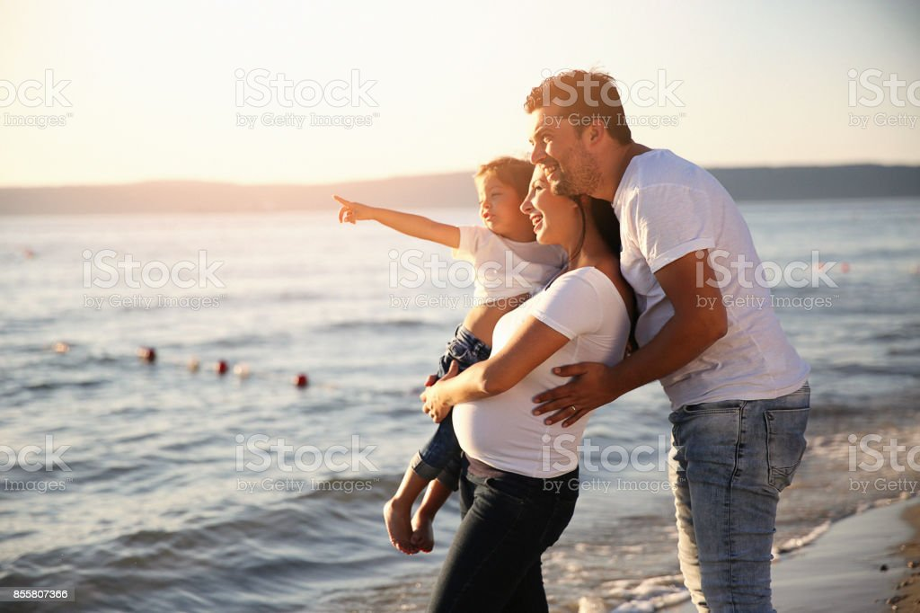 Young  family holding their daughters and laughing together stock photo