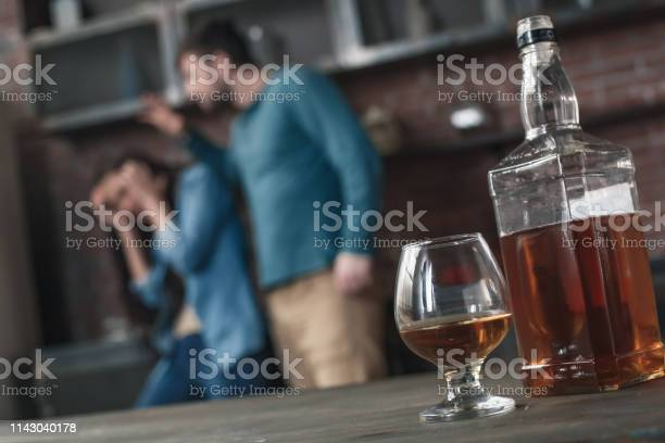 Young family husband alcoholic social problems concept whiskey picture id1143040178?b=1&k=6&m=1143040178&s=612x612&h=482dvlu 1bt9zakifxnbjrmt4y yd4crdrmasqqm1qa=