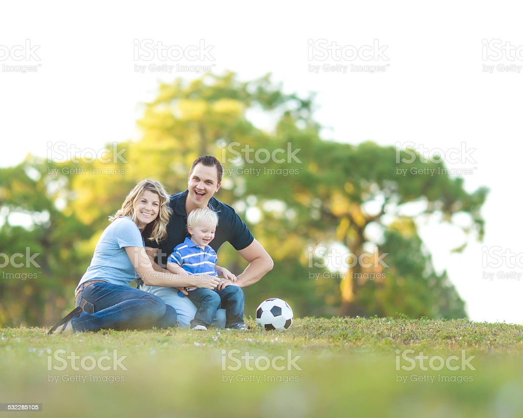 Young family in a park. stock photo