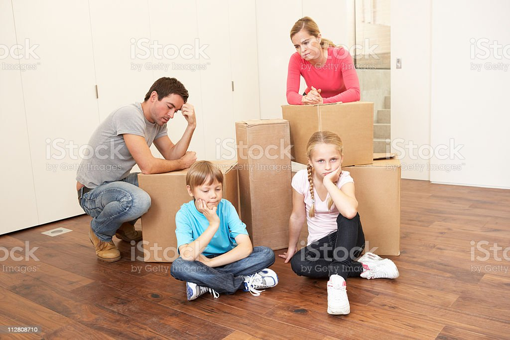 Young family looking upset among boxes royalty-free stock photo