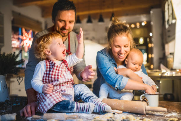 young family making cookies at home. - christmas cooking imagens e fotografias de stock