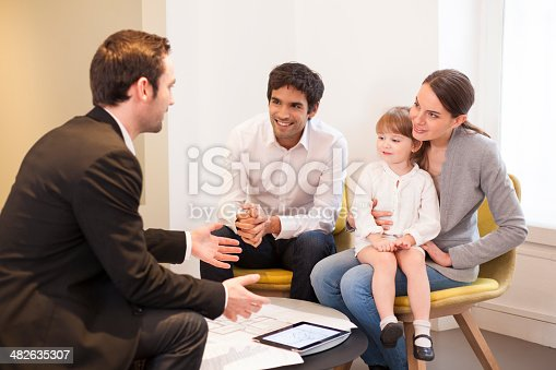 istock Young Family meeting real-estate agent to buy property 482635307