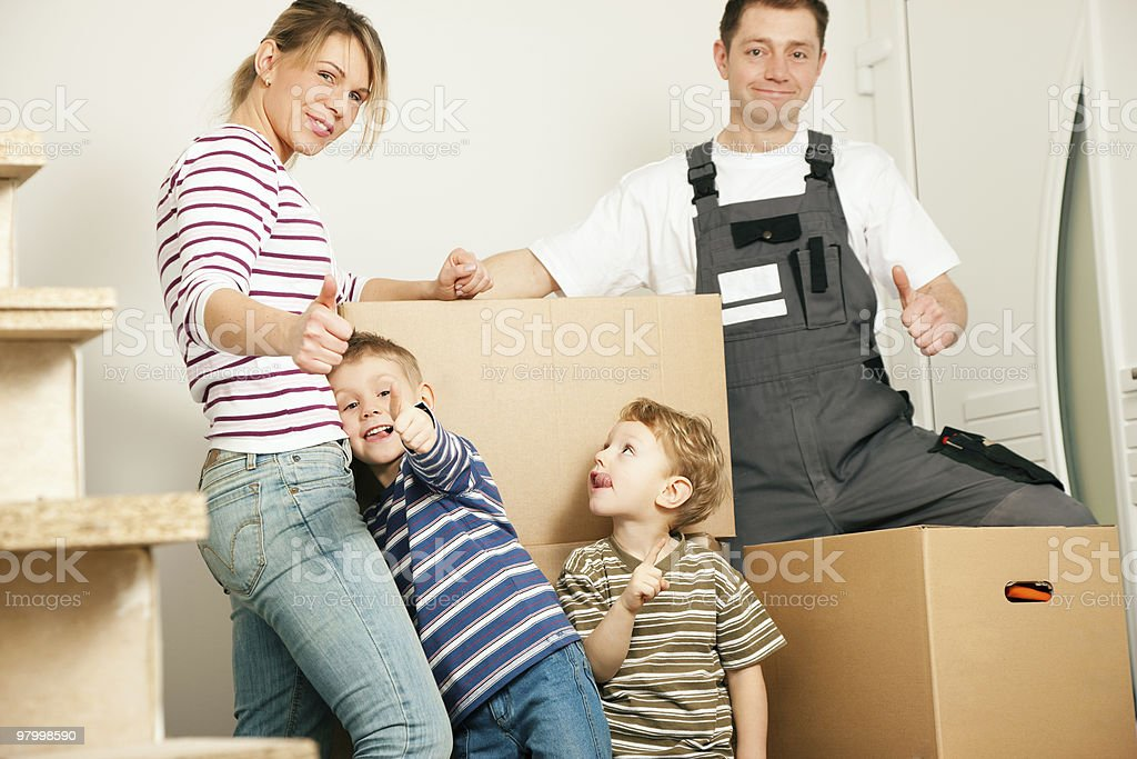 A young family moving into a new home royalty-free stock photo