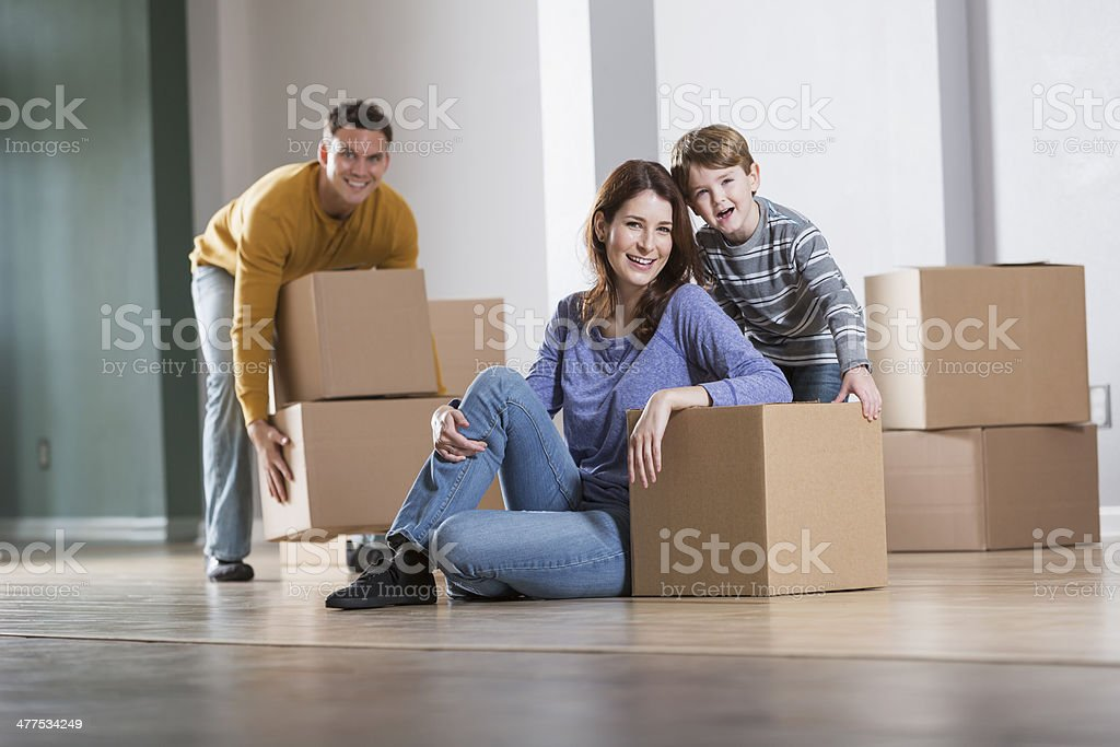 Young family moving stock photo