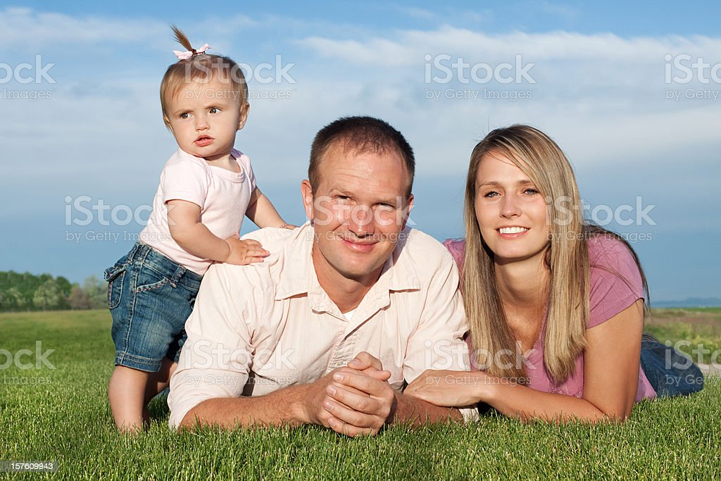 Young Family of Three in Nature Setting royalty-free stock photo