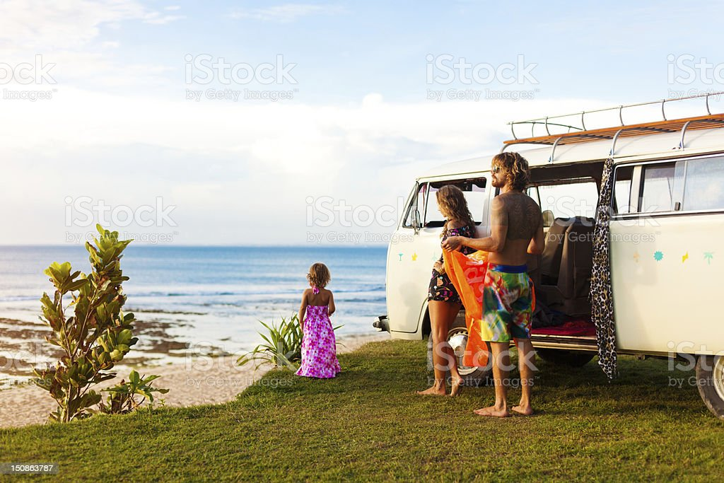 young family on a beach royalty-free stock photo