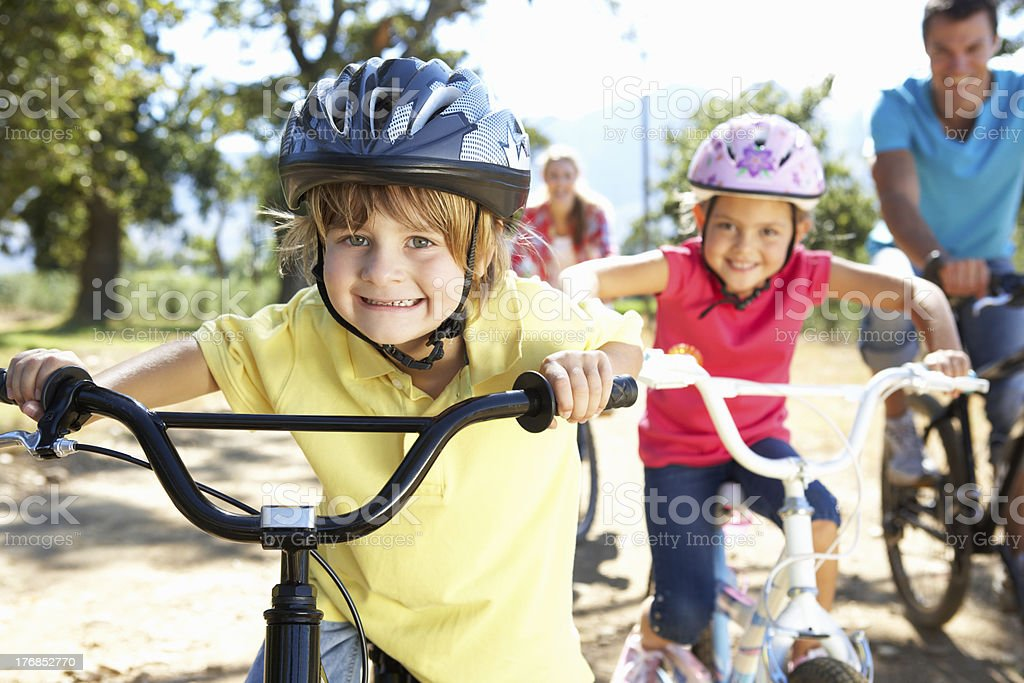 Young family on country bike ride stock photo