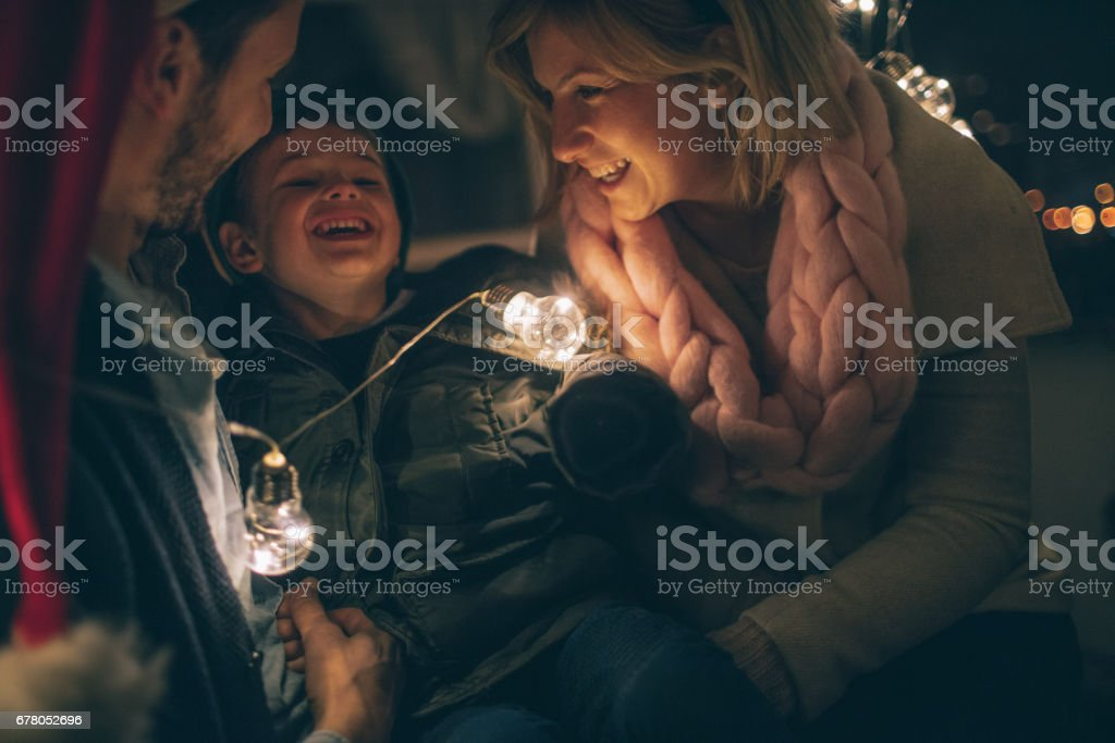 Young family on New Year's Eve stock photo