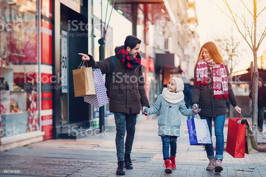 Young family on shopping stok fotoğrafı