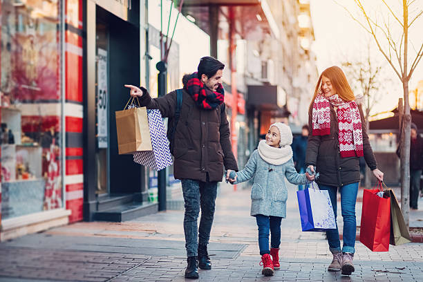 Young family on shopping stock photo