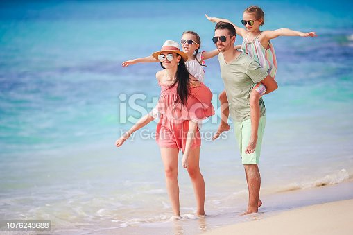 istock Young family on vacation on the beach 1076243688
